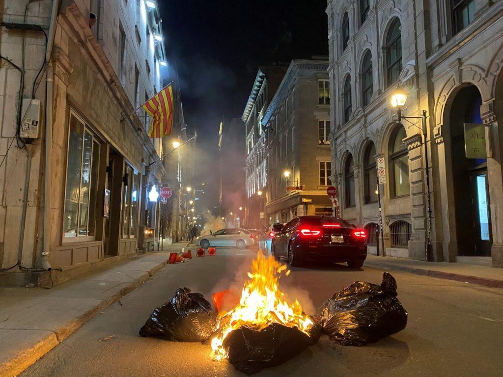 تحول مظاهرة فى مونتريال مناهضة لحظر التجول إلى أعمال عنف  بالصور